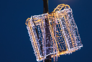 Christmas Street Decorations: Illuminated Christmas Street decorations, in the shape of a present, positioned on a streetlight