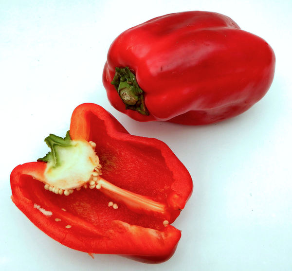 red cut capsicum1: fresh cut red capsicums - red bell peppers
