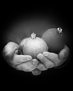 baubles in hands grainy