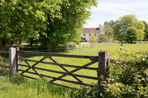 Rural gate and house