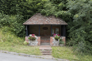 Rural bus shelter: A bus shelter in rural West Sussex, England.