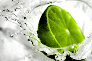 Lime Light: Lime splashing into water. Extremely shallow DoF