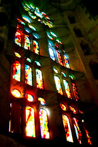 Stained Glass: A stained glass window in the beautiful Temple de la Sagrada Familia.