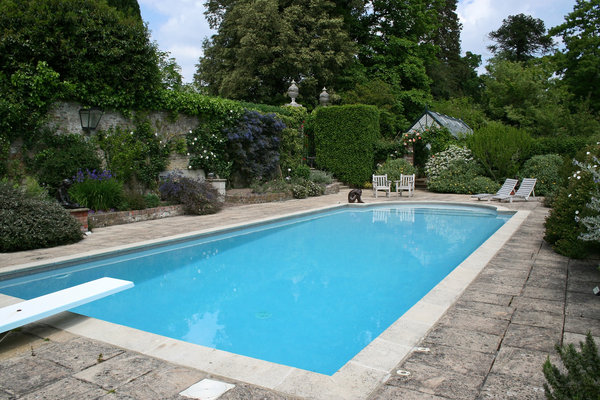 Swimming pool: A swimming pool in the garden of a stately house in East Sussex, England.