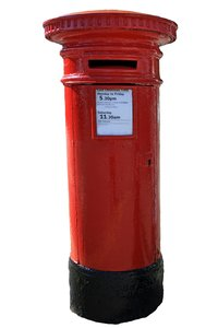 Post Box: British traditional red post box isolated against a white background