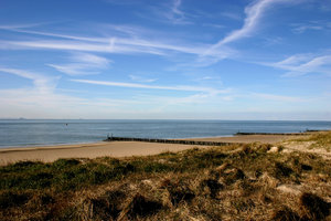 dunes, sea and beach: the dunes, sea and blue sky on a sunny day in February. The Netherlands near Vlissingen.