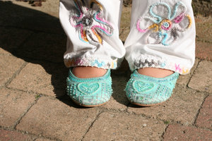 little shoes: feet and bit of legs of a little girl