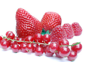 Strawberries, raspberries and: Some raspberries, strawberries together with red berries.