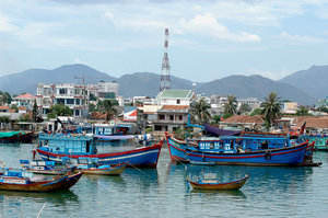 boats: Fishing boats in a harbor in Nha Trang, Vietnam.