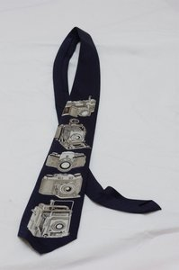 Camera: Neck tie with camera print.