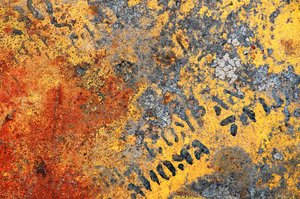 Bottom of the Drum: The grungy underside of a metal drum.