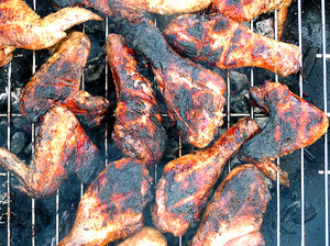 Grilled chicken legs: Grilled chicken legs and wings. A little too grilled :).Please mail me or comment this photo if you liked or used it. Thanks in advance.