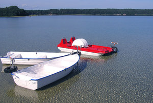 Boats on the lake: Some boats on a small lake port in Narty, Poland.Please mail me or comment this photo if you liked it. Thanks in advance.I would be happy to receive the information about picture usage. I would be extremely happy to see the final work even if you think it