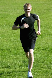 Jogger: Young male running in athlete's kit