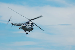 Military helicopter flying: Military helicopter flying