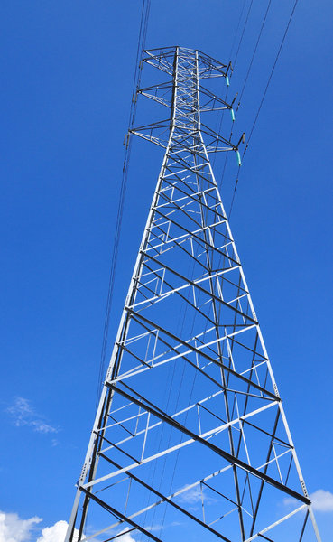 Electricity tower: Electricity tower seen from below, against blue sky