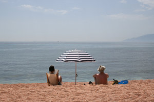 Vacation: Holidaymakers on a beach in Sardinia.