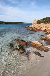 Quiet cove: Clear aquamarine seawater in a quiet cove in Sardinia.