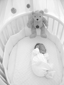 Isabelle Grace in cot