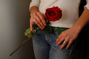 Rose: Tammy holding a single long stem rose.