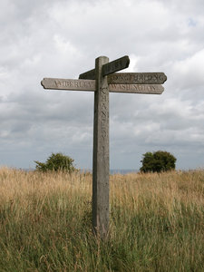 Signpost: A signpost for long-distance footpaths on the South Downs, West Sussex, England.