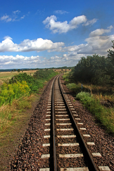 Rural landscape with the rail: Rail under the clouds