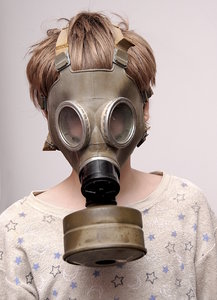Boy in the soviet gas mask  1: Mask worn over the face to protect the wearer from inhaling airborne pollutants and toxic materials