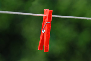 Clothes Peg 1: Just a stock photo. Wet clothes peg on wire.