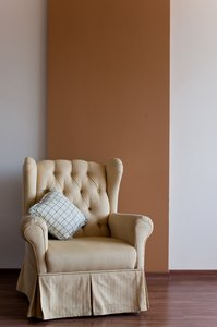 Chair and wall: Yellow chair in front of a brown wall