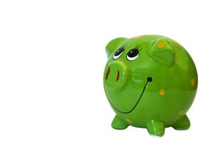 Green Piggy Bank: A colourful, smiley piggy bank.  Lots of copy space.