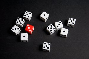 Dice I: Ten white dice and a single red die, all showing odd numbers.