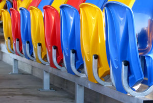 Colourful Chairs: pretty plastic chairs in a stadium.