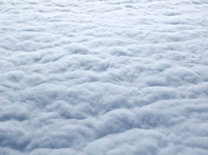 Fluffy Sea of Clouds 1: The view from above the clouds on a flight to the UK.