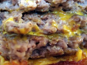 greasy: a greasy burgers meat , cheese and sauce....makes me ill just looking at this! lol