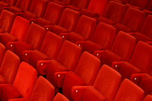 Theatre Seats: Red seats in an empty theatre