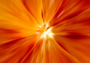 Sunburst: Macro shot of a blood orange with zoom blur added.