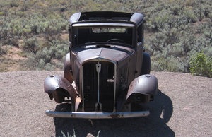 old auto wreck: rusty car on the side of the road in California