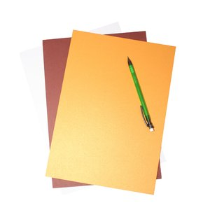 paper: Coloured paper. One with an ebossed top sheet another with a pencil on top