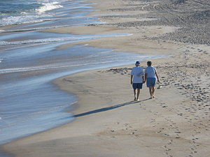 Later Walk: Couple enjoying the beach.