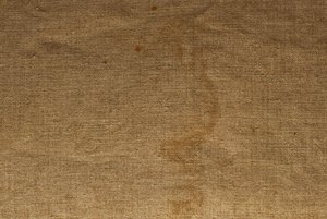 Grungy Linen Texture: A detailed shot of some loose art canvas that has been in the garage for a long time. It has some wrinkles and stains to add to its character.