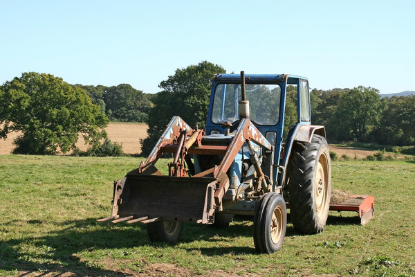 Tractor: A tractor parked after a day's work in fields in West Sussex, England.