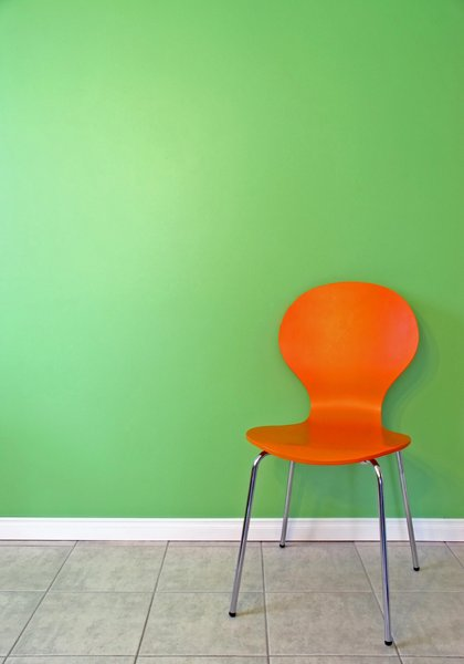 Green Wall 2: Orange chair in front of a green wall.