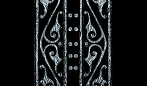 Book Cover: Ancient patterns in metal on the outside of a book cover in black and silver. Suitable for diary covers, etc.
