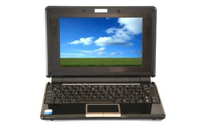 Laptop: Laptop with screen displaying blue sky field landscape (woodsy copyright image)