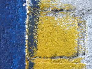 Mexican paint close-up: Closeup of some colorful paint on a wall in Mexico.