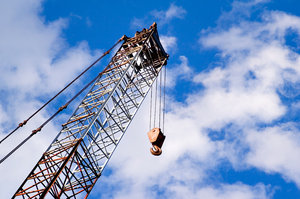Under Construction: View of a crane at a construction site.