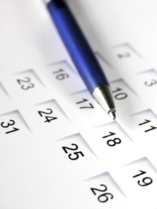 Pen on calendar: blue pen on a calendar sheet