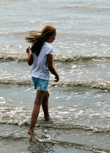 Walking Carefully: Unknown girl in Galveston Bay