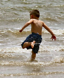 Kicking Feet: Boy playing in the bay