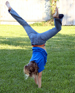 Handstand: 8 year old standing on her hands